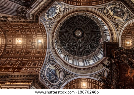 ROME, ITALY - MARCH 24 2014: Interior Ceiling Shot of the Basilica St. Peter in the Vatican on MARCH 24 2014 in Rome in Italy