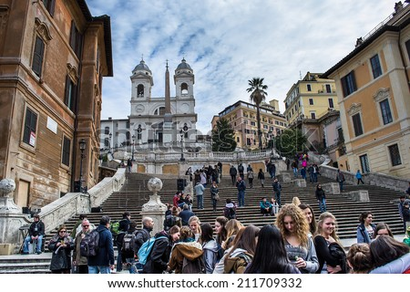ROME,ITALY-MARCH 17,2013:people walking on the steps of spanish cathedral admiring the church Trinity of the mountains in rome - stock photo
