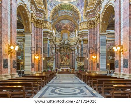 ROME, ITALY - MARCH 25, 2015: The nave of baroque church Basilica dei Santi Ambrogio e Carlo al Corso. - stock photo