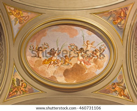 ROME, ITALY - MARCH 11, 2016: The symbolic fresco of angels with the flowers on the ceiling of side nave in church Basilica di Santi Giovanni e Paolo by unknown artist of 18. cent.