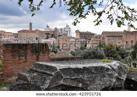 ROME, ITALY - MARCH 15, 2016: Tourists visiting the archaeological site of the Roman Forum (Foro Romano) near the Colosseum, part of Unesco heritage in Rome, Italy - stock photo