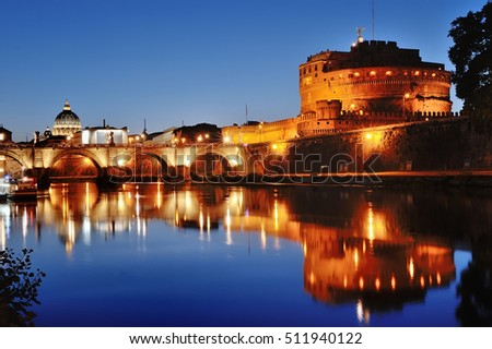 Rome, Italy - Mausoleum of Hadrian and river Tiber at night, on background St. Peter's Basilica dome in Vatican