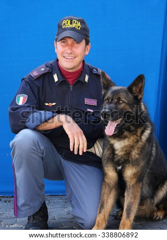Rome, Italy - May 17, 2008: A trainer of the police department and his dog lovers dog breed German Shepherd, taken during the public celebrations of the 156th anniversary of the Italian Police. - stock photo