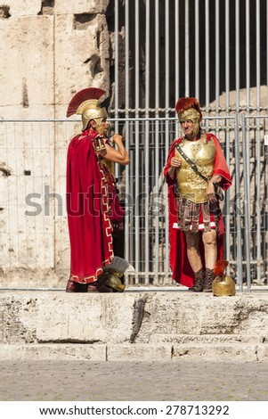 ROME, ITALY - MAY 22, 2014: Actor depicting a Roman legionary for tourists near the Colosseum. Rome, Italy - stock photo