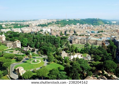 ROME, ITALY - MAY 31: Aerial view of Rome city from St Peter Basilica roof to Vatican gardens on May 31, 2014, Rome, Italy.