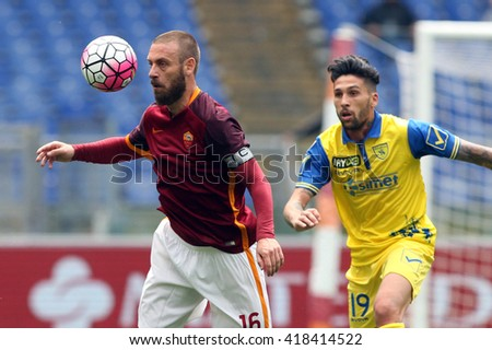 "ROME, ITALY - MAY 2016 :De Rossi and Nahuel in action during fotball match  of Italian League ""Serie A"" between A.s. Roma vs Chievo at the Olimpic Stadium on May 8, 2016 in Rome.  (ph Marco Iacobucci)"