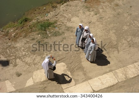 ROME, ITALY - MAY 22, 2015: group of Catholic  sisters, who rarely leave their convents, take a picture along river Tiber - stock photo
