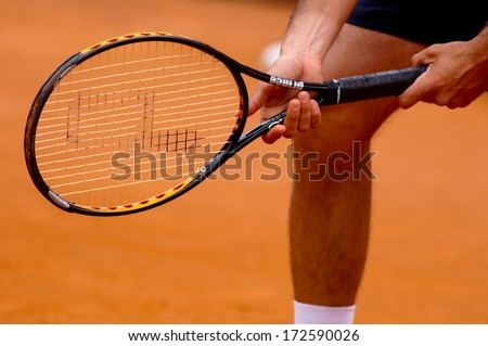 "ROME, ITALY - MAY 09: International Tennis tournament ""Internazionali d'Italia"" in Rome, May 09, 2006. A tennis player holding the racket. - stock photo"