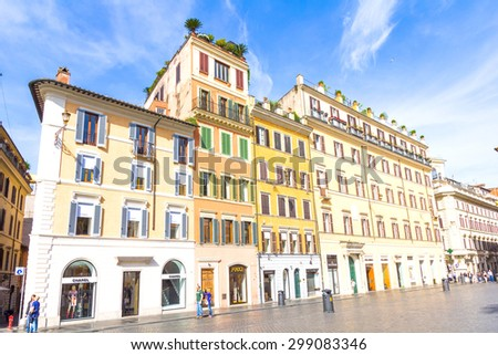 ROME, ITALY - MAY 4, 2015 : People walking in the Piazza di Spagna. The place has many monuments as the Fontana della Barcaccia and the Spanish Steps and is one of the most visited sites in Rome. - stock photo