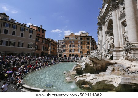 ROME, ITALY - MAY 21, 2014 - tourists in front of fontana di trevi, rome, italy