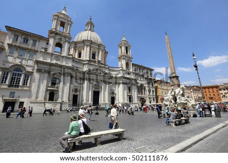 ROME, ITALY - MAY 21, 2014 -tourists in piazza navona, rome, italy