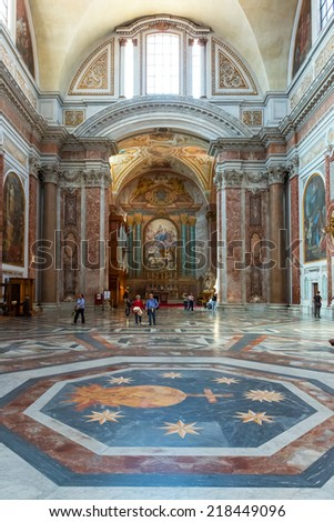 ROME, ITALY - MAY 8, 2014: Tourists visit the Basilica of St. Mary of the Angels and the Martyrs (Santa Maria degli Angeli e dei Martiri), built inside the Baths of Diocletian in the 16th century. - stock photo