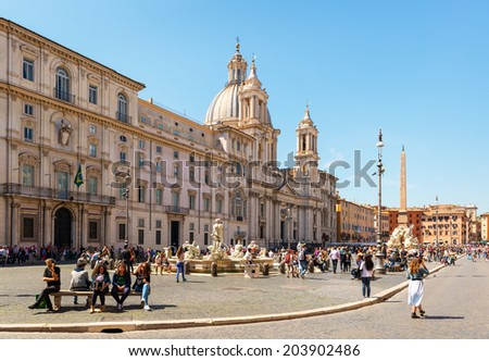 ROME; ITALY - MAY 9; 2014: Tourists visit the Piazza Navona. Piazza Navona is one of the most beautiful places in Rome. - stock photo