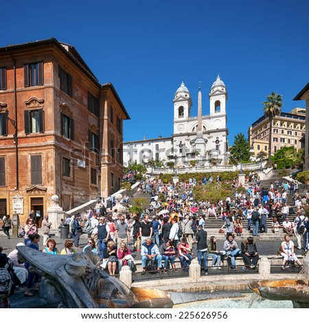 ROME - ITALY, MAY 15, 2012: Tourists visiting the Spanish Steps.  Spanish Steps  are a set of steps in Rome. It is one of Rome's most popular tourist attractions.  - stock photo