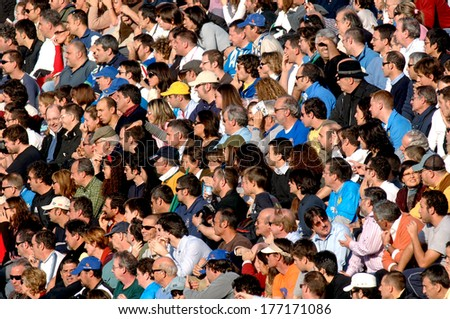 ROME, ITALY-NOVEMBER 16, 2006: Italian spectators watching the Six Nations Rugby Tournament match Italy vs France. - stock photo