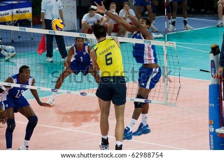 ROME, ITALY - OCTOBER 10: Brazil GLeandro Vissotto Neves spikes ball at Volleyball World Championships  final match Brazil vs Cuba at Palalottomatica in Rome on October 10, 2010