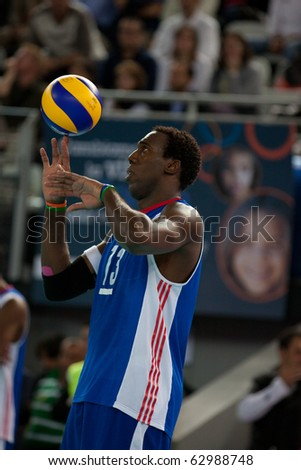 ROME, ITALY - OCTOBER 10: Cuba Robertlandy Simon Aties prepares to serv at Volleyball World Championships  final match Brazil vs Cuba at Palalottomatica in Rome on October 10, 2010