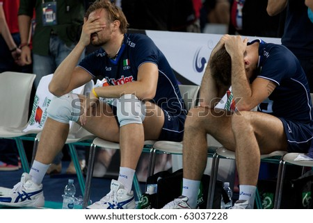 ROME, ITALY - OCTOBER 10: Italian team react after losing match at Volleyball World Championships bronze medal match Italy vs Serbia at Palalottomatica in Rome on October 10, 2010