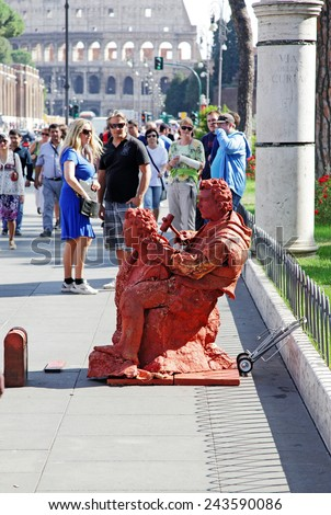 ROME, ITALY - OCTOBER 08, 2012: Living Sculpture Near Colosseum - stock photo