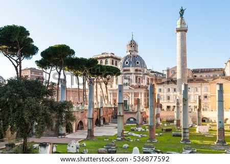 ROME, ITALY - OCTOBER 31, 2016: piazza of Trajan's Forum, Trajan Column, Santissimo Nome di Maria al Foro Traiano Church in ancient roman forums in Rome city. The Forum was inaugurated in 112.