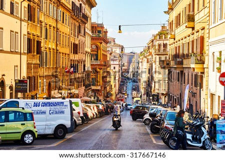 ROME, ITALY - OCTOBER 30: Streets of Rome are full of traffic and people throughout the day in Rome, Italy on October 30, 2014.