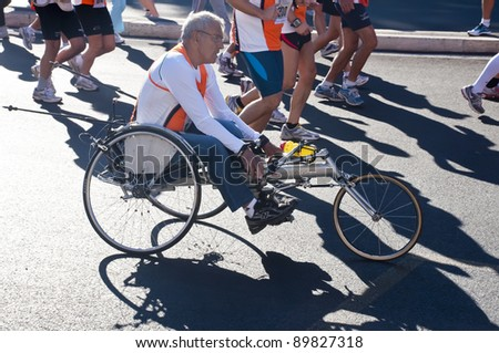 ROME,ITALY-OCTOBER 16:unidentified athlete in an adapted vehicle in  sixth edition disabled the Run for Food race on October 16,2011 in Rome,Italy.Approximately 1298 athletes participate in the race - stock photo