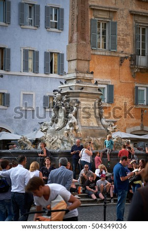 ROME, ITALY - OCTOBER 25, 2016: Visitors stand by the Renaissance fountain in the Pantheon square