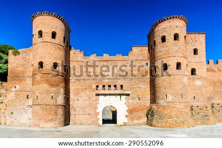 Rome, Italy. Porta Asinaria is a gate in the Aurelian Walls of Rome, ancient landmark from Roman Empire, stone walled largest city of the world. - stock photo