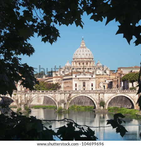 ROME - ITALY. River Tiber, Ponte Sant Angelo and St. Peter's Basilica in the background. - stock photo