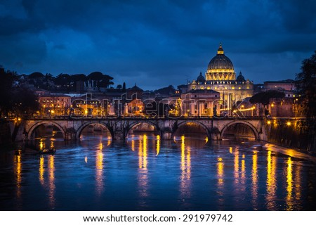 Rome, Italy. Saint Peter Church reflecting itself on Tevere river during the evening. - stock photo