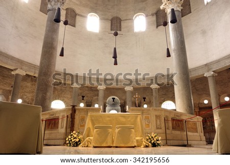 ROME, ITALY - SEPTEMBER 26, 2015: ancient church of Santo Stefano Rotondo, the Altar in the middle of the building - stock photo