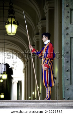 Rome, Italy - September 22, 2011: Swiss guardsman of the papal guard duty at the Saint Peters Basilica in the Vatican city in Rome. - stock photo