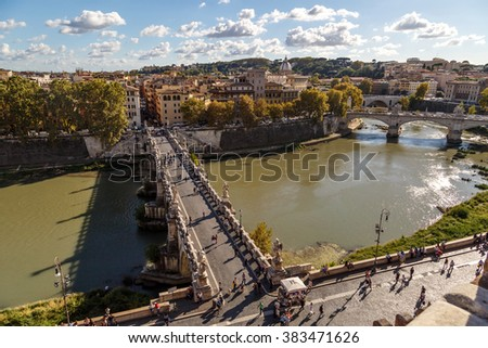 ROME, ITALY - SEPTEMBER 25, 2015 : View of Ponte Sant'Angelo in front of Castle of the Holy Angel on Tiber River, on cloudy blue sky background. - stock photo