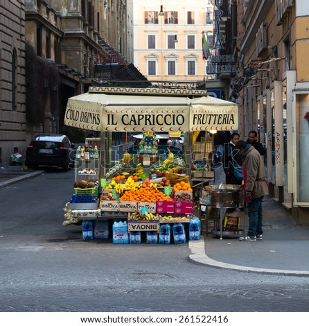 ROME - ITALY, 11TH MARCH 2015: A fruit stand in rome during the day. People can be seen near the stand - stock photo