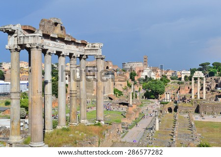 Rome, Italy. View of the Roman Forum on the background of the stormy sky