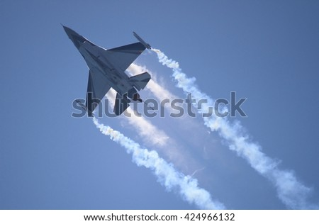 ROME - JUNE 28: A F-16 of the Netherland Air Force performs at the Rome International Air Show on June 28, 2014 in Rome, Italy - stock photo