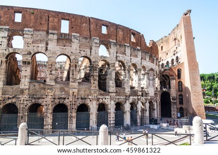 ROME - JUNE 24: Colosseum exterior on June 24, 2014 in Rome, Italy. The Colosseum is one of Rome's most popular tourist attractions with over 5 million visitors per year. - stock photo