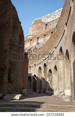 ROME - MARCH 23: North part of Colosseum interior in morning light on March 23, 2012 in Rome. - stock photo