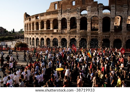 ROME - MAY 30: anti G8 manifestation in Rome city center before G8 meeting in L'Aquila. Mass of people demonstring in front of colosseum on May 30, 2009 in Rome, Italy. - stock photo