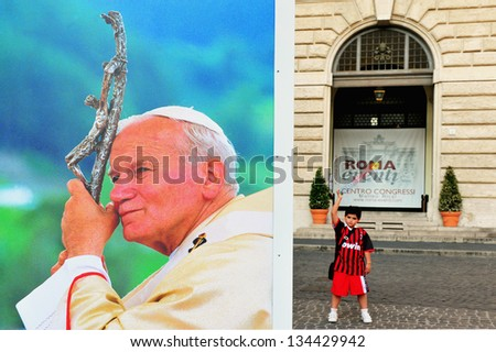 ROME - MAY 01:Giant banner of  pope John Paul's portrait in the streets of Rome during his ceremony of beatification on May 1 2011 at St Peter's square at Vatican city in Rome Italy. - stock photo