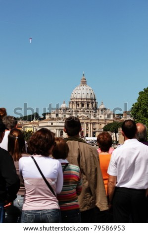 ROME - MAY 1: People look at the fasade of Saint Peter's Cathedral during the celebration for the John Paul II beatification on May 1,2011 in Rome - stock photo