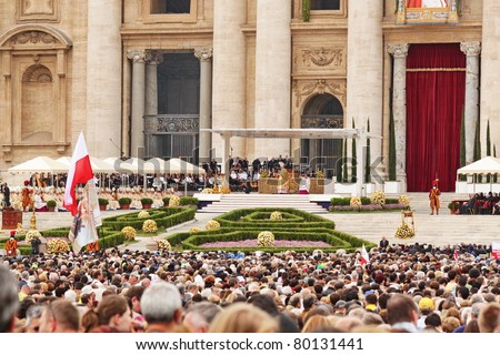 ROME - MAY 1 : pilgrims listen to the mass during the beatification of Pope John Paul II on may 1, 2011 in Rome - stock photo