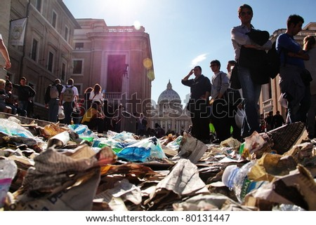 ROME - MAY 1 : pilgrims walk on the rubbish left on st Peter's square during the beatification of Pope John Paul II on may 1, 2011 in Rome - stock photo