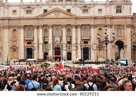 ROME - MAY 1 : polish pilgrims listen to the mass during the celebration for the beatification of Pope John Paul II on may 1, 2011 in Rome - stock photo