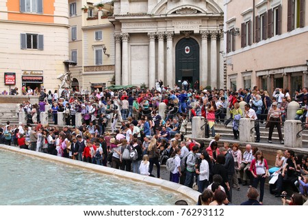 ROME - MAY 11: Tourists watch Trevi Fountain on May 11, 2010 in Rome, Italy. Trevi Fountain is among most iconic fountains in the world and one of Italy's top tourism destinations. - stock photo