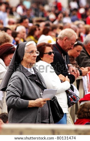 ROME - MAY 1 : unidentified elderly nun listens to the mass during the beatification of Pope John Paul II on may 1, 2011 in Rome - stock photo
