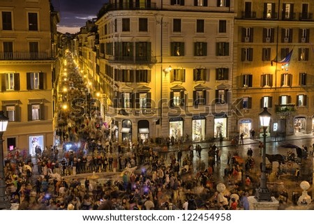 ROME - NOV 3: People walks in Piazza di Spagna and Spanish Steps, November 3, 2012 in Rome. Near 5 million people come to visit the city every year