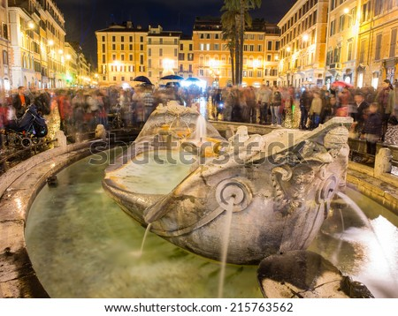 ROME - NOVEMBER 1, 2012: Fountain of Piazza di Spagna is one of the most famous landmarks of Rome. The square owes its name to the palace of Spain, Embassy of the Iberian been to the Holy See - stock photo