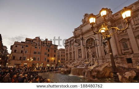 ROME - OCT 25: Tourists visiting the Trevi Fountain on October 25, 2011 in Rome. Trevi Fountain is one of the most iconic fountains in the world. - stock photo
