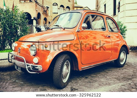 ROME - OCTOBER 12: Red Fiat 500 parked on October 12, 2013 in Rome. Italy - stock photo